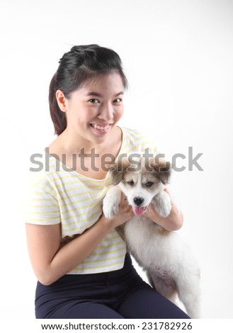 Girl holding Thai Bang Kaew Puppy isolated on white