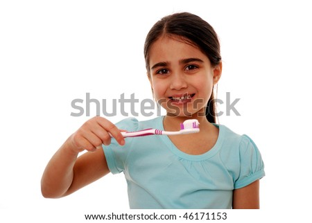 Girl holding toothbrush isolated on white