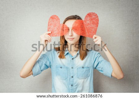 girl holding two paper hearts - stock photo