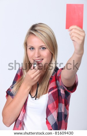 Girl holding up red card - stock photo