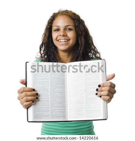 Girl holds bible open - stock photo