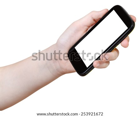 girl holds mobile phone with cut out screen isolated on white background - stock photo