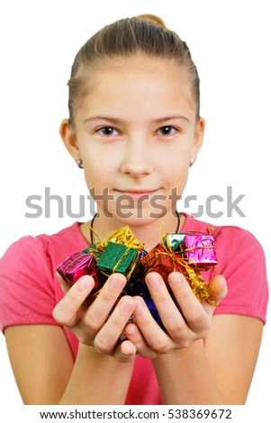 Girl holds tiny gifts (focus on the boxes)