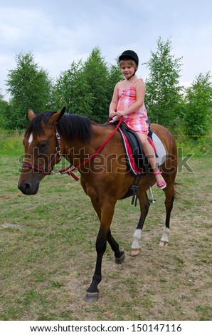 Girl horse riding - stock photo