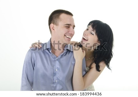 girl hugging a man and they laugh together - stock photo