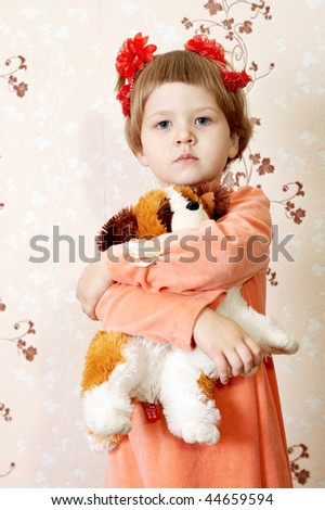 girl hugging a toy - stock photo