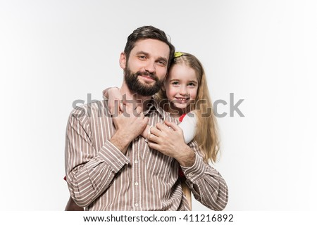 Girl hugging her father  over a white background