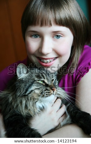 Girl hugging her kitty - stock photo