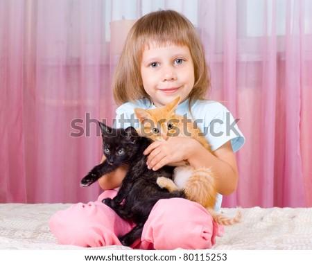 Girl hugging red and black kitten - stock photo