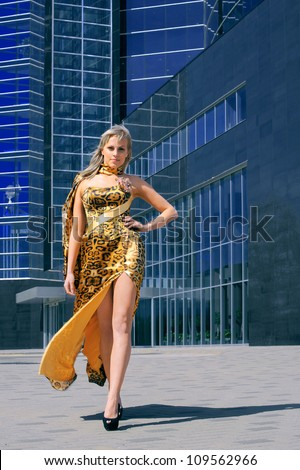 girl in a beautiful dress on a background of the business center - stock photo