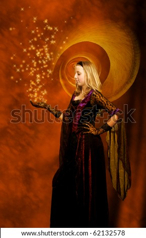 girl in a beautiful gothic dress with stars above her hand - stock photo
