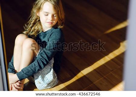 girl in a bim of light - stock photo