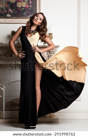 girl in a black dress in the interior - stock photo
