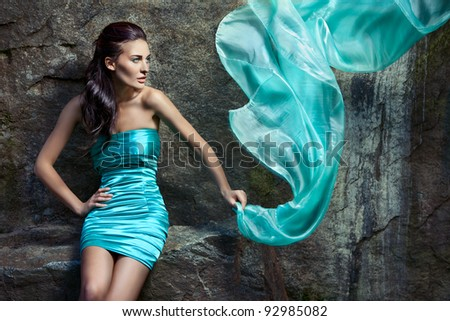 Girl in a blue dress with a loop in hand - stock photo