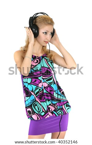 girl in a bright dress with headphones - stock photo