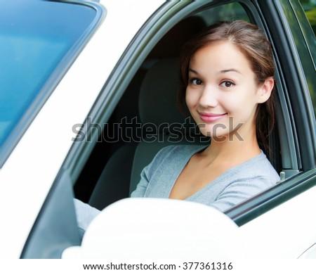 Girl in a car - stock photo