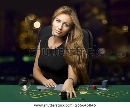 girl in a casino playing poker, bokeh - stock photo