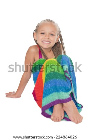 Girl in a colorful dress sitting on the floor. Girl six years. - stock photo