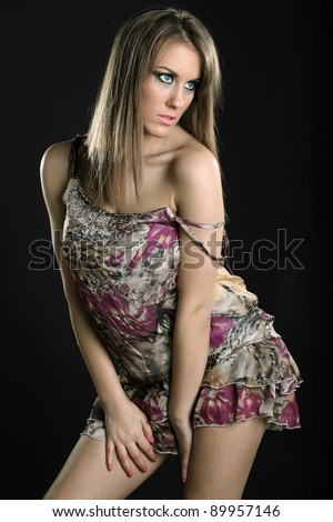 girl in a dress on a black background
