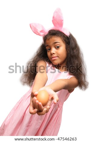 girl in a easter bunny costume with an easter egg in her hands