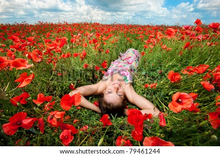 girl in a field of poppies - stock photo