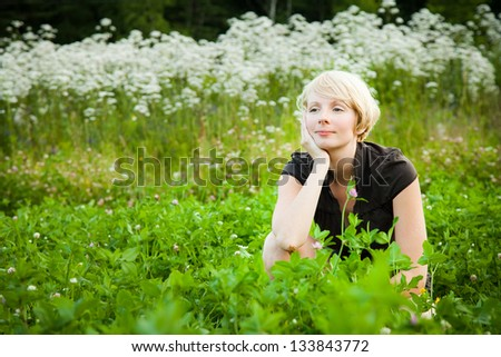 Girl in a field of white flowers