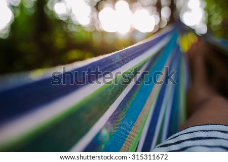 Girl in a hammock close up - stock photo