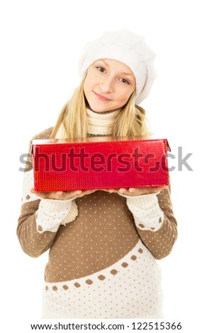 girl in a hat holding a gift box isolated on white background - stock photo