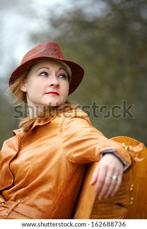girl in a hat on the nature - stock photo