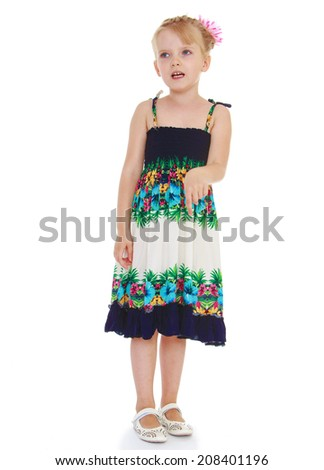 girl in a long dress shows thumb down on white background.kindergarten, the concept of childhood and joy, teens - stock photo