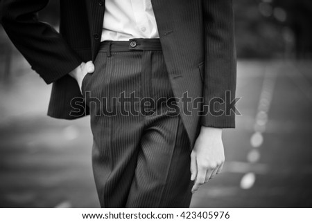 girl in a man's suit. black and white photo