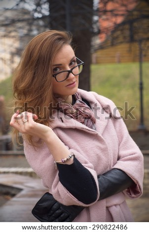 girl in a pink coat portrait in Kiev - stock photo