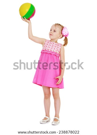 girl in a pink dress holding a ball. Isolated on white background studio photo. - stock photo