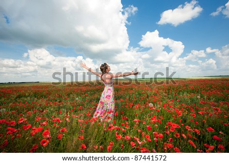 girl in a poppy field - stock photo