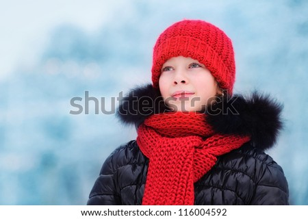 girl in a red cap in winter - stock photo