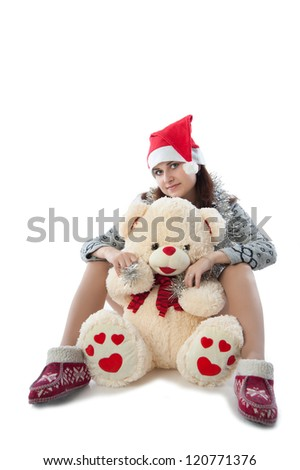 girl in a red cap sits with a teddy bear - stock photo