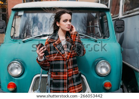 girl in a street with earphones - stock photo