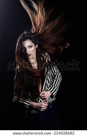 Girl  in a striped jacket on a black background