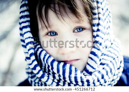 Girl in a striped scarf - stock photo