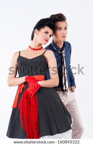 Girl in a vintage suit and stylish man looking away. Retro style
