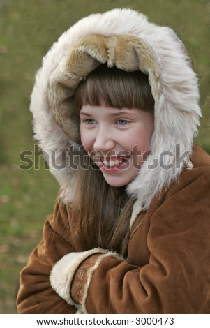 Girl in a warm coat laughing