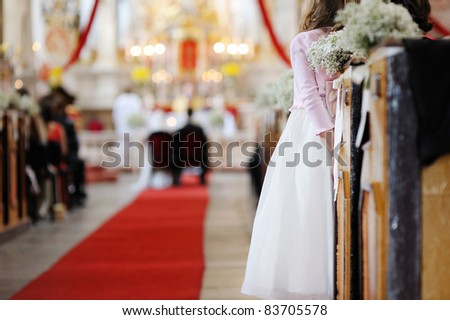 Girl in a white dress watching wedding ceremony - stock photo