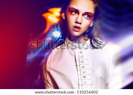 girl in a white t-shirt in flashlights - stock photo