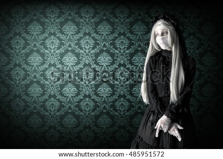 Girl in a widow black dress with white eyes looking like a doll