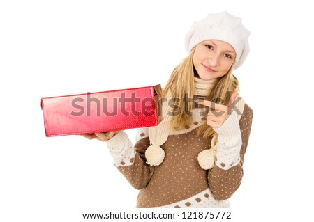 girl in a winter cap points to gift - stock photo