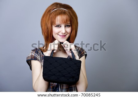 Girl in american 50s-60s style with handbag. - stock photo