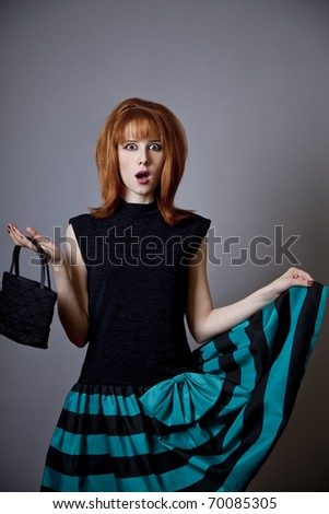 Girl in american 50s-60s style with handbag.