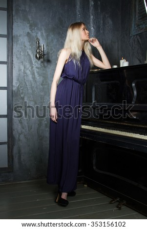 girl in an evening dress on a background of piano