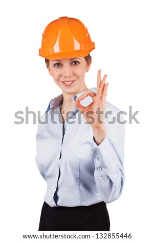 Girl in an orange helmet shows that all okay