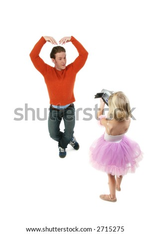 Girl in ballerina costume takes video of silly dad in ballet pose; full body on white background - stock photo